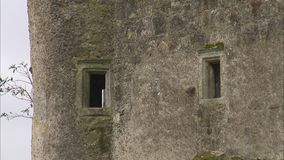 Small castle windows. A steady wide shot of small windows of an old castle in Ireland stock footage