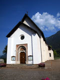 Small Catholic church in the resort town of Dimaro in the Brenta Royalty Free Stock Photo