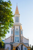 A small Catholic Church which is located near the road in the capital of Vietnam. Stock Photos