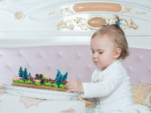 Small caucasian child girl on happy birthday with cake at home Royalty Free Stock Images