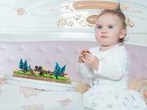 Small caucasian child girl on happy birthday with cake at home. Small caucasian child on happy birthday with cake at home stock photography