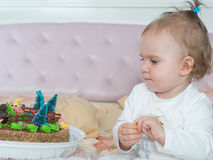 Small caucasian child girl on happy birthday with cake at home Royalty Free Stock Photo