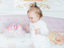 Small caucasian child girl on happy birthday with cake at home Royalty Free Stock Image
