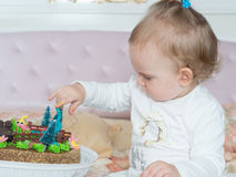 Small caucasian child girl on happy birthday with cake at home Stock Photos