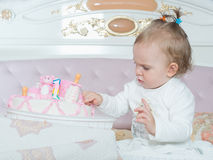 Small caucasian child girl on happy birthday with cake at home Stock Images