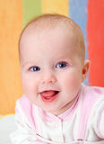 Small caucasian  girl  infant is dared. Royalty Free Stock Photo