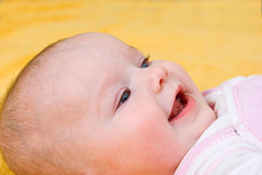 Small caucasian girl infant is dared. Stock Images