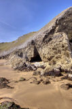 A small cave on a beach Stock Image