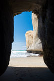 Small cave at the Tunnel beach Stock Photos