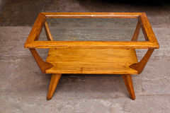 Small center table. Old wooden small center table restored and varnished Royalty Free Stock Photos