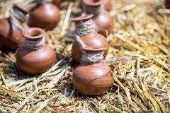 Small ceramic crocks or pot on straw Stock Photo