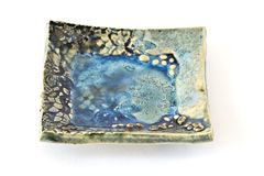 Small ceramic earthenware plate Stock Photography