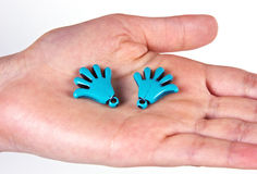 Small ceramic hands with fingers. Isolated woman hand holding small ceramic hands with fingers Royalty Free Stock Image