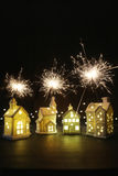 Small ceramic houses with sparklers Royalty Free Stock Image