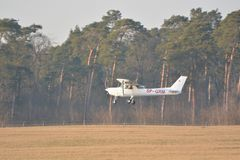 Small Cessna plane landing Stock Photography