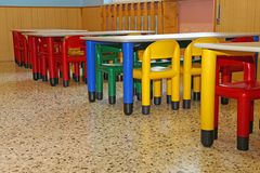 Small chairs and tables of a refectory in kindergarten Royalty Free Stock Photo