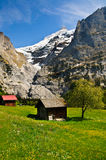 Small Chalet with mountain backdrop, Grindelwald Stock Image