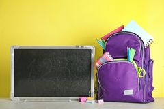 Small chalkboard and backpack with different school royalty free stock photography