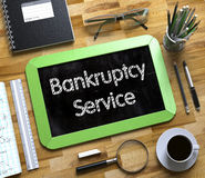 Small Chalkboard with Bankruptcy Service Concept. 3D. Royalty Free Stock Images