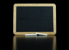 Small Chalkboard on a Black Reflective Background Stock Image