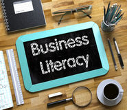 Small Chalkboard with Business Literacy Concept. 3D. Royalty Free Stock Images