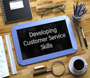 Small Chalkboard with Developing Customer Service Skills. 3D. Royalty Free Stock Images