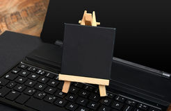 Small Chalkboard on Keyboard keys with copy space.  Royalty Free Stock Image