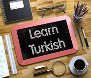 Small Chalkboard with Learn Turkish. 3D Illustration. Stock Photos