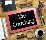 Small Chalkboard with Life Coaching. 3D Render. Royalty Free Stock Photo