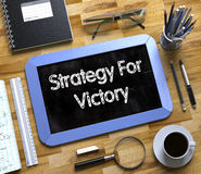 Small Chalkboard with Strategy For Victory Concept. 3D. Royalty Free Stock Photos