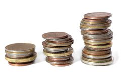Small change. Three piles of coins in ascending positions. All isolated on white background Royalty Free Stock Image