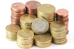 Small change. Piles of euro coins isolated on white background money and finance concepts Stock Photos