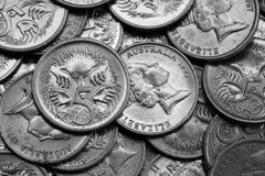Small Change. A closeup of Australian 5 cent coins in black and white Stock Photos