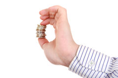 Small Change in Hand. Isolated on the white background Royalty Free Stock Photo