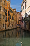 Small Channels Cross in Venice. Small Channels cross between the Buildings Stock Photo