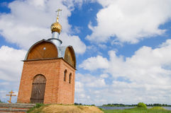 Small chapel on bank of the river Royalty Free Stock Image