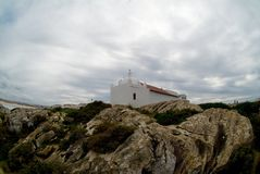 Small chapel on a cliff, Baleal, Portugal. Capelo do Baleal in Baleal, Portugal. Its standing on a cliff looking out over the Atlantic Ocean Stock Images