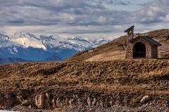Small chapel in high mountains. With snowy mountains in the background Royalty Free Stock Photography