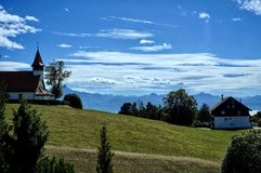 A small chapel on a hill, mountains and blue sky. A small chapel on a hill, in Epalinges, Switzerland stock photos