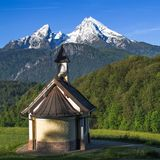 Small chapel Kirchleitn and snow-capped summits of Watzmann mountain. Square stock photo captured in German national park Berchtesgaden Stock Photo