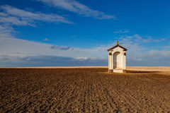 A small chapel in the middle of fields Royalty Free Stock Photo