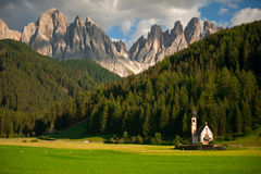 Small chapel and mighty Dolomite mountains Stock Image