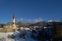 Small chapel in mountain. View of small chapel surronded by mountains and snow Stock Photography