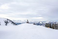 Small chapel on the mountain Wallberg covered with snow, Bavarian Alps, Bavaria, Germany Stock Photo