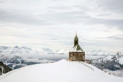 Small chapel on the mountain Wallberg covered with snow, Bavarian Alps, Bavaria, Germany Stock Photos