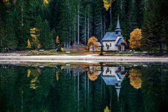 Small Church On The Italian Braies Lake with reflections stock images