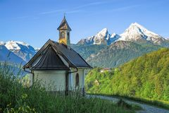 Small chapel and snow-covered Watzmann mountain in Berchtesgaden Royalty Free Stock Images