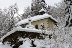 Small chapel in the snow Royalty Free Stock Images