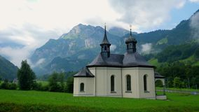 Small chapel in the Swiss Alps. Travel photography stock video