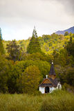 Small chapel in the woods. Surrounded by mountains in Patagonia Stock Images
